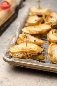 A close up of brie and caramelized onion grilled cheese on a tray