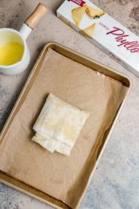 phyllo wrapped feta on a parchment lined baking sheet