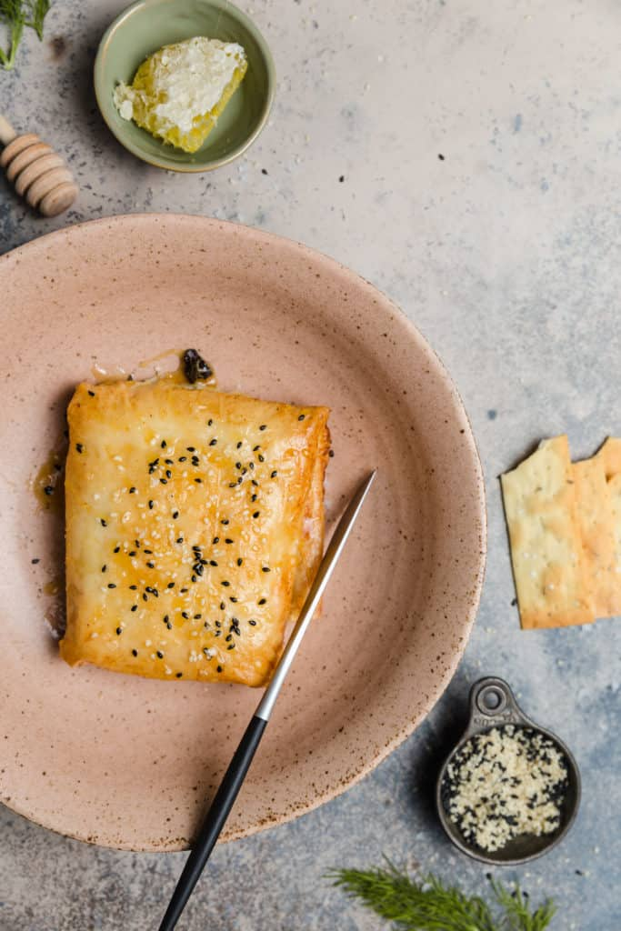 crispy phyllo wrapped feta in a bowl with sesame seeds
