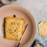 phyllo-wrapped feta with sesame seeds in a bowl