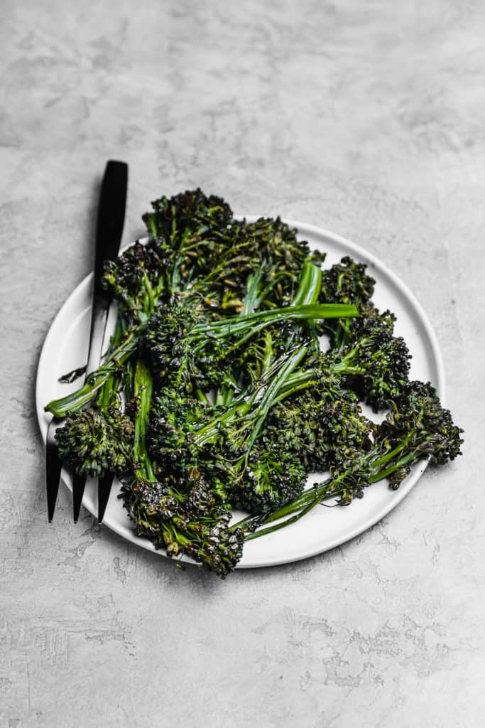 roasted broccolini on a white plate