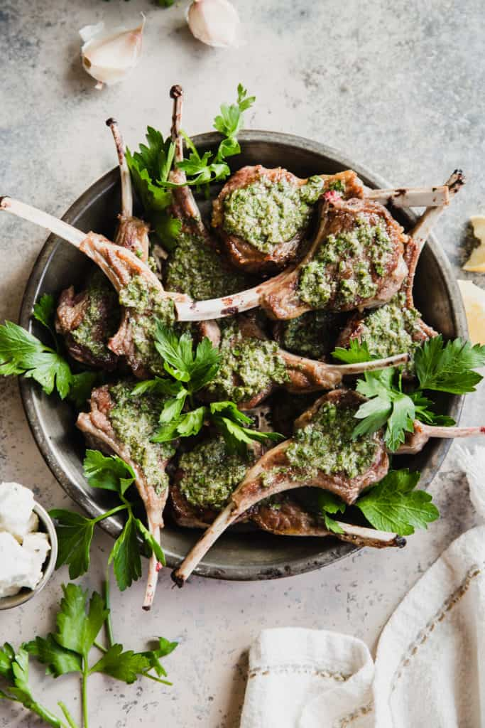 platter of seared lamb lollipops with parsley