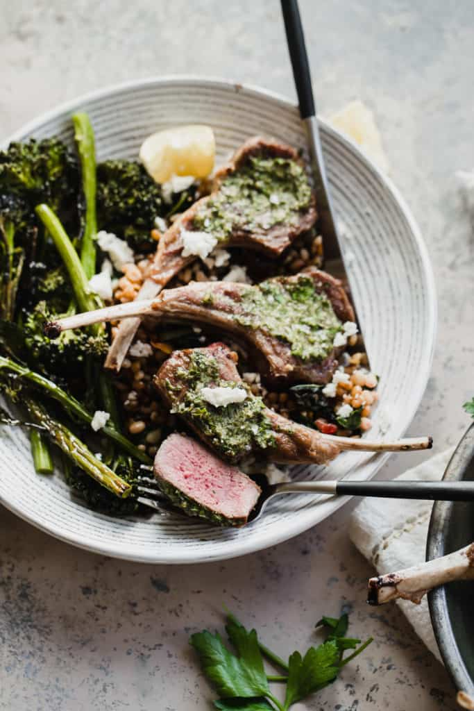 sliced pan-seared lamb chop with broccolini and feta