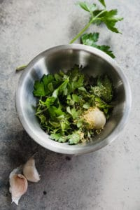fresh herbs, garlic, and lemon zest in a bowl