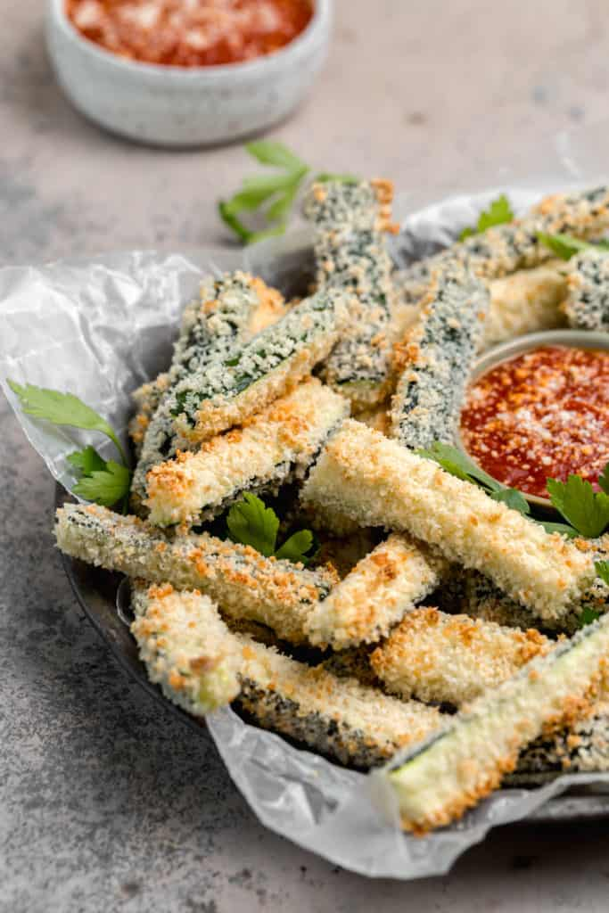 close up of panko coated zucchini fries on a tray