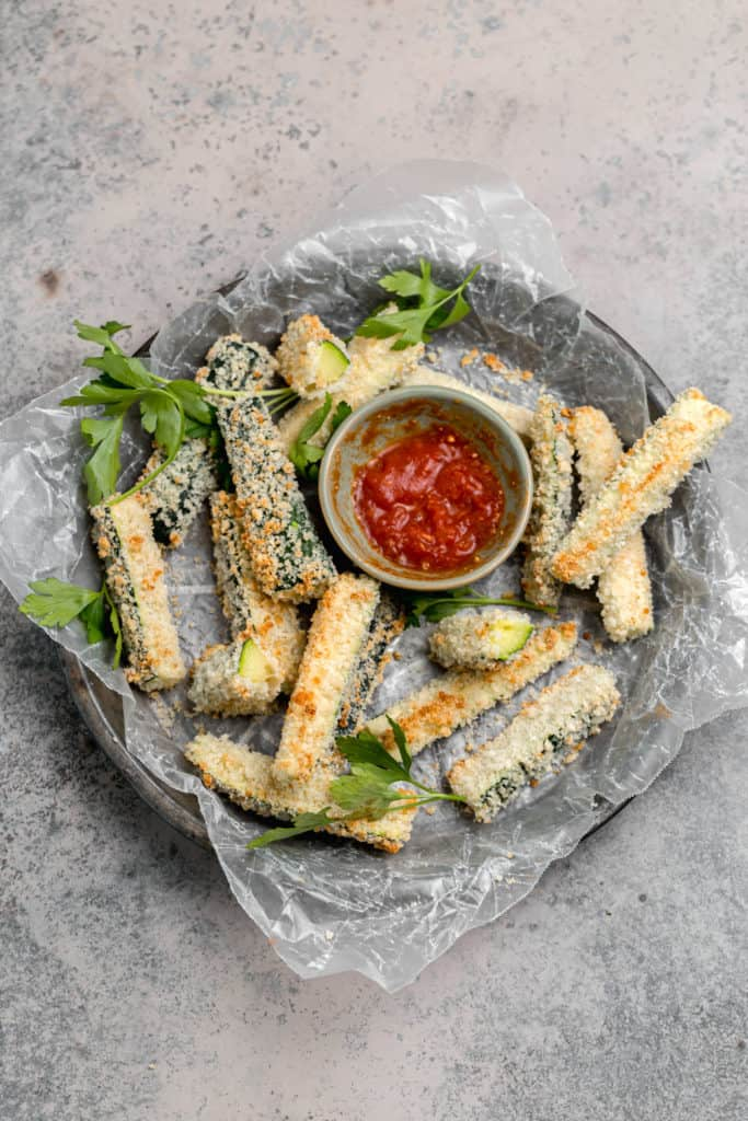half a plate of eaten baked zucchini fries