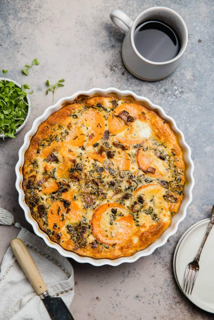 goat cheese and veggie quiche in a quiche pan
