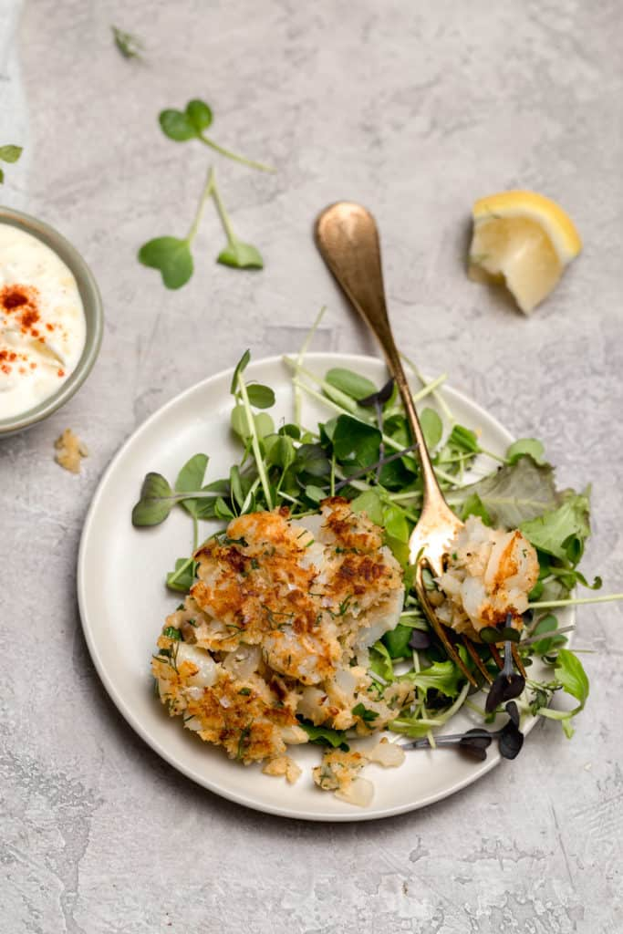 cod cake with mixed greens and tartar sauce