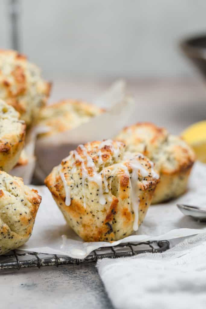lemon poppy seed muffins on a wire rack with glaze