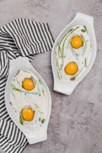 eggs with heavy cream and asparagus in ramekins
