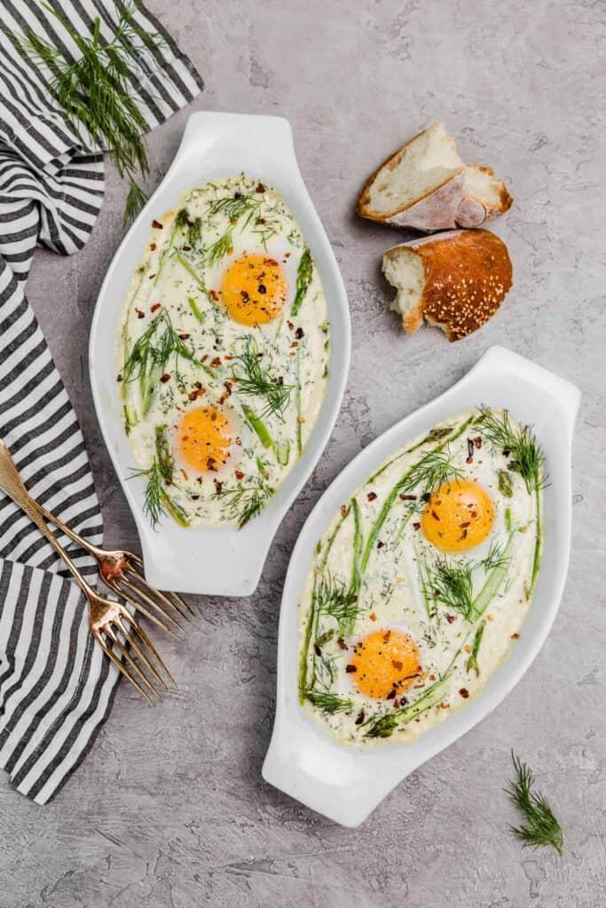 baked eggs in white oval ramekins