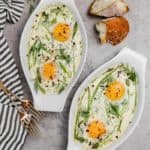 baked shirred eggs in ramkeins with fresh herbs