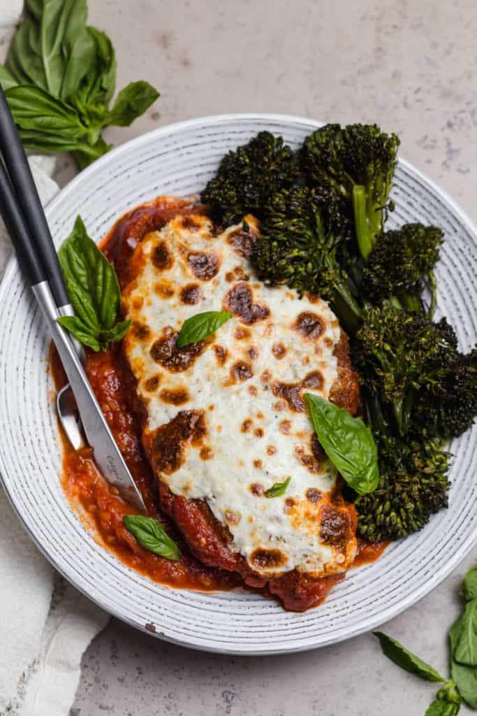 easy weeknight chicken parmesan with fresh basil and roasted broccolini
