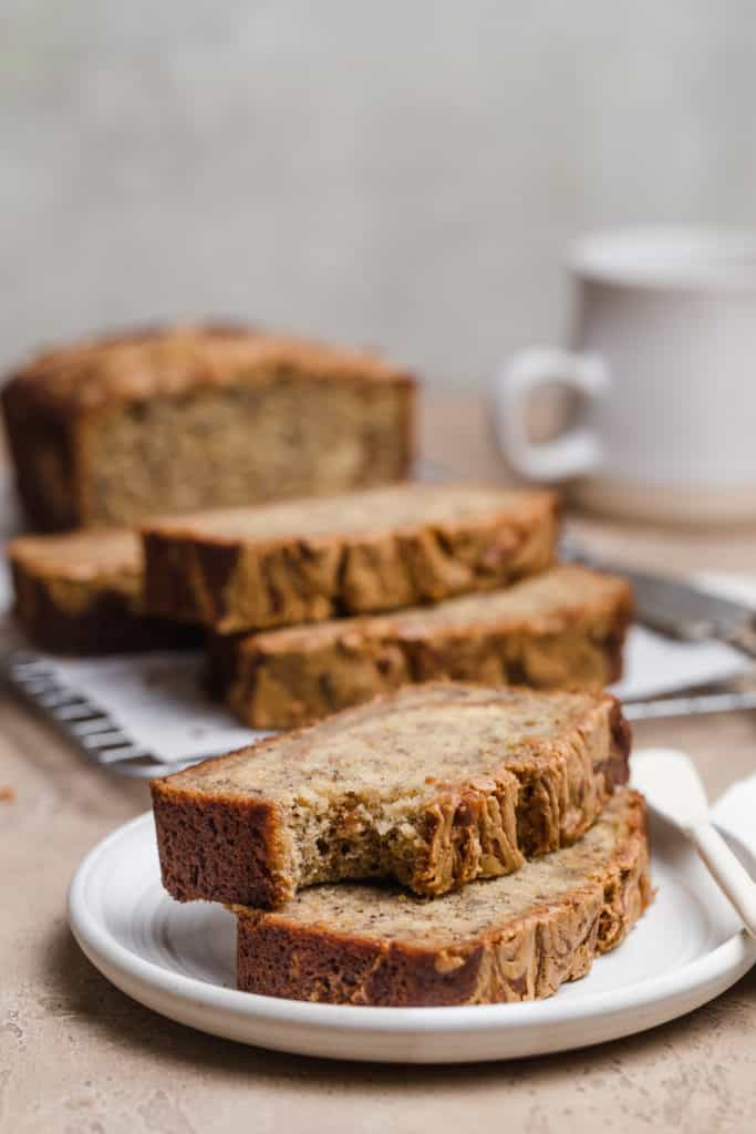 stacked slices of banana bread on a white plate