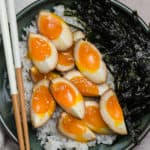 7 minute soy sauce eggs on top of sticky rice with seaweed