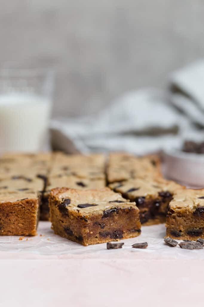 chocolate chunk blondies with a glass of milk