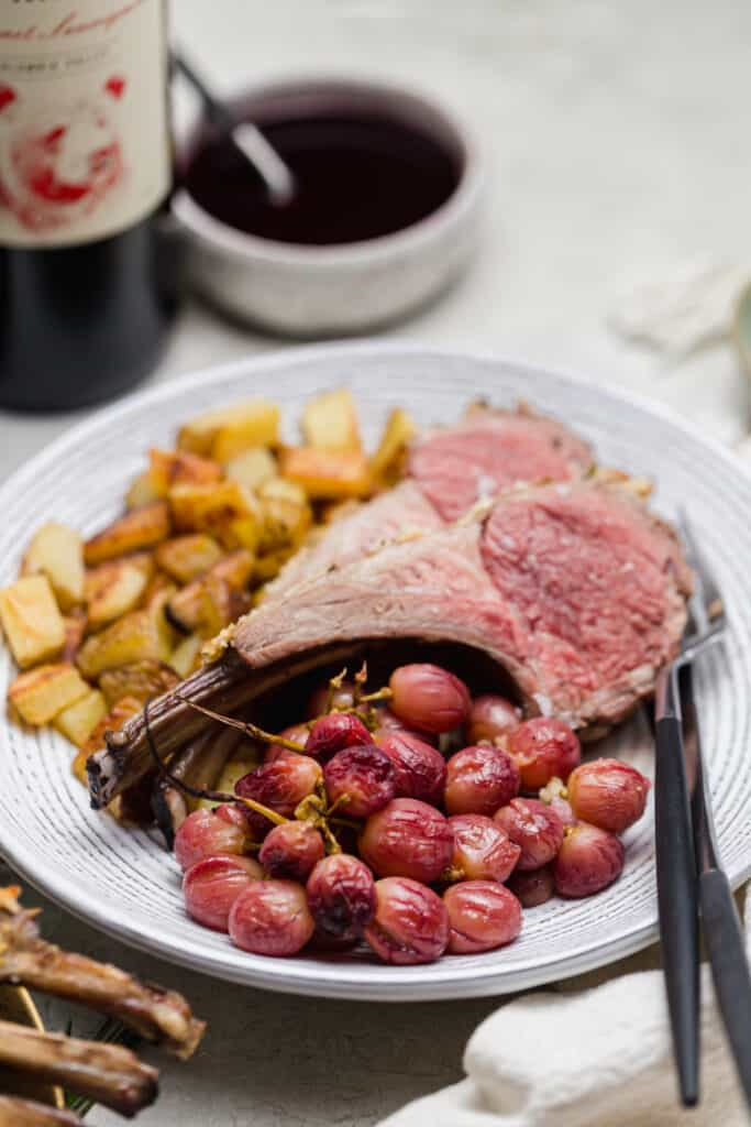 panko crusted rack of lamb with roast potatoes and grapes