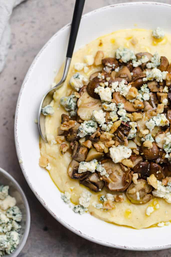 creamy parmesan polenta with mushrooms, shallots, and blue cheese