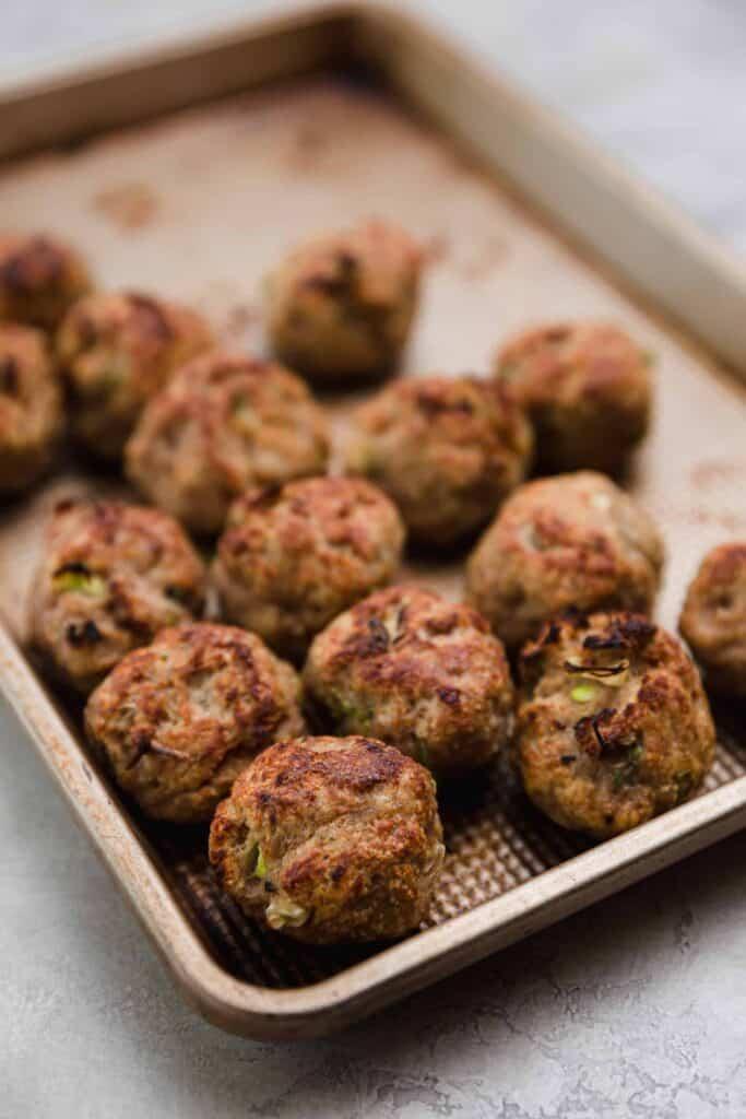 homemade turkey meatballs on a baking sheet