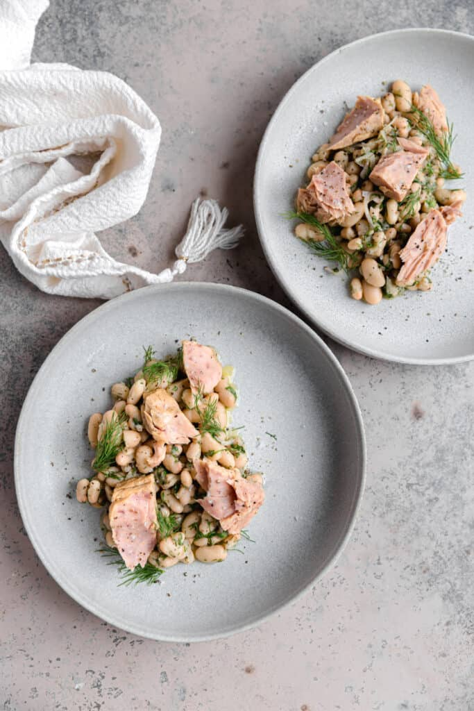white bean salad with tuna and dill in gray bowls