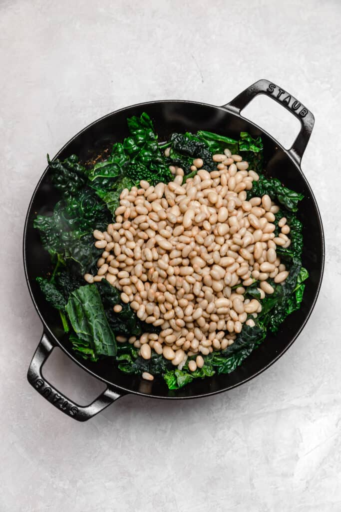 lacinato kale and white beans in a skillet