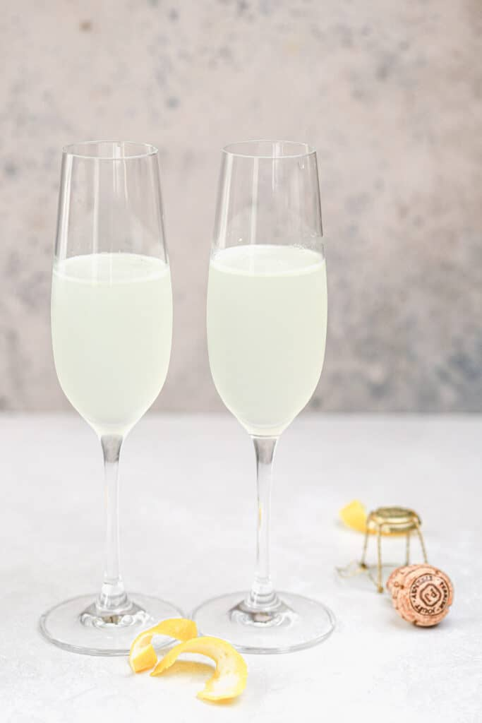 gin, lemon juice, and simple syrup in flute glasses
