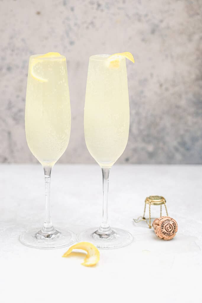 french 75 cocktails in flute glasses with lemon peels for garnish