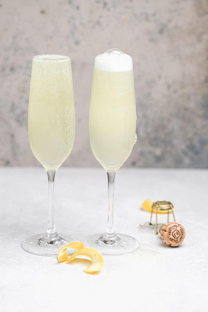 classic french 75 cocktail in champagne flutes
