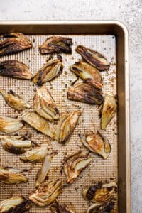 roasted fennel on a rimmed baking sheet