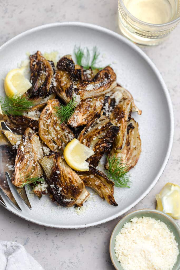 roasted fennel with lemon and parmesan on a grey plate