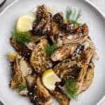 roasted fennel with parmesan and lemon on a gray plate