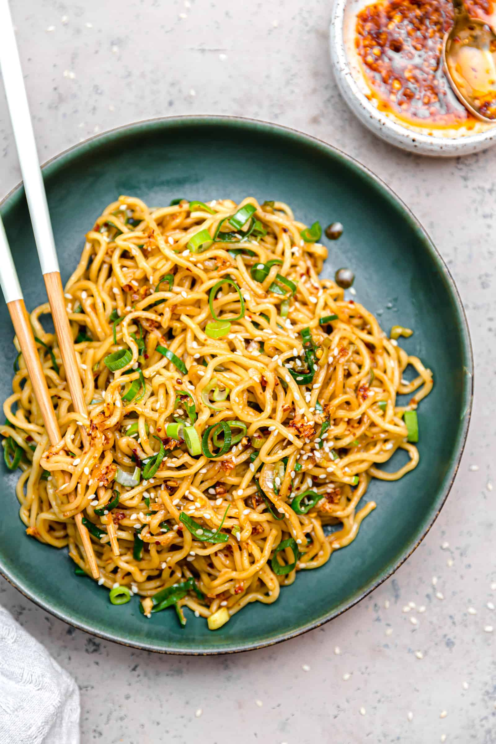 spicy ramen noodles with scallions and sesame