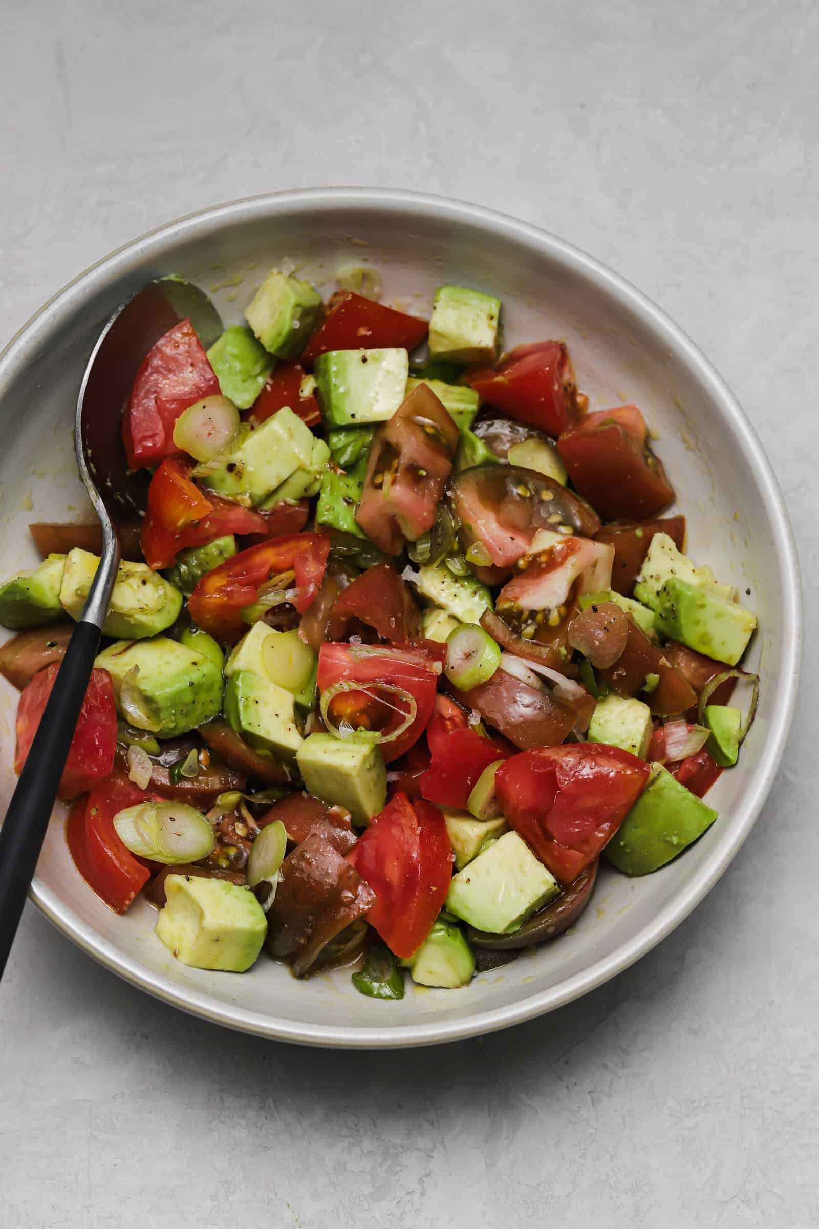 quick tomato salad with avocado and scallions