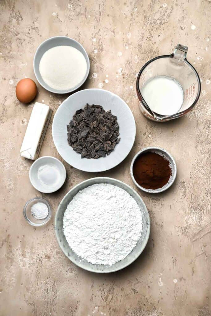 Ingredients for double chocolate scones on a beige board