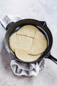 tortillas in a cast iron skillet