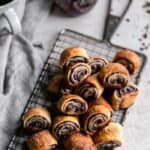 homemade chocolate raspberry rugelach on a cooling rack
