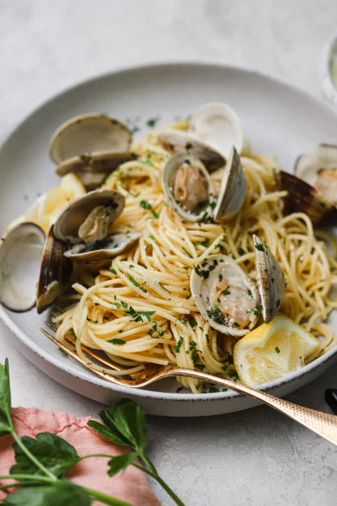close up of spaghetti alle vongole with a gold fork
