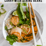Thai curry with seared scallops and garlic string beans with white rice in a bowl and lots of fresh herbs on top