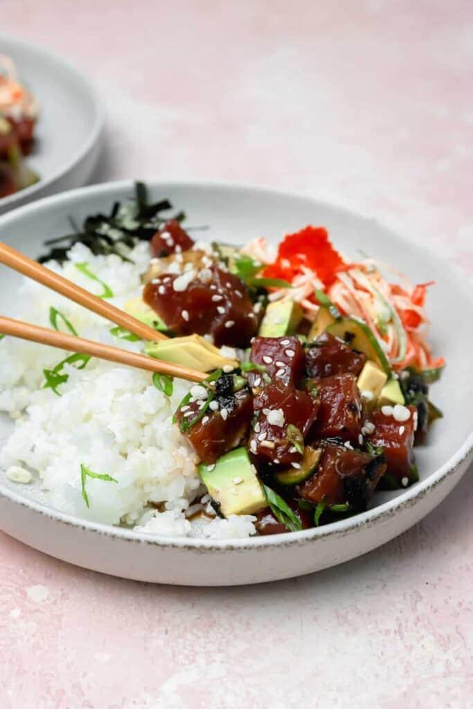 ahi tuna poké bowls with sticky sushi rice on a gray plate
