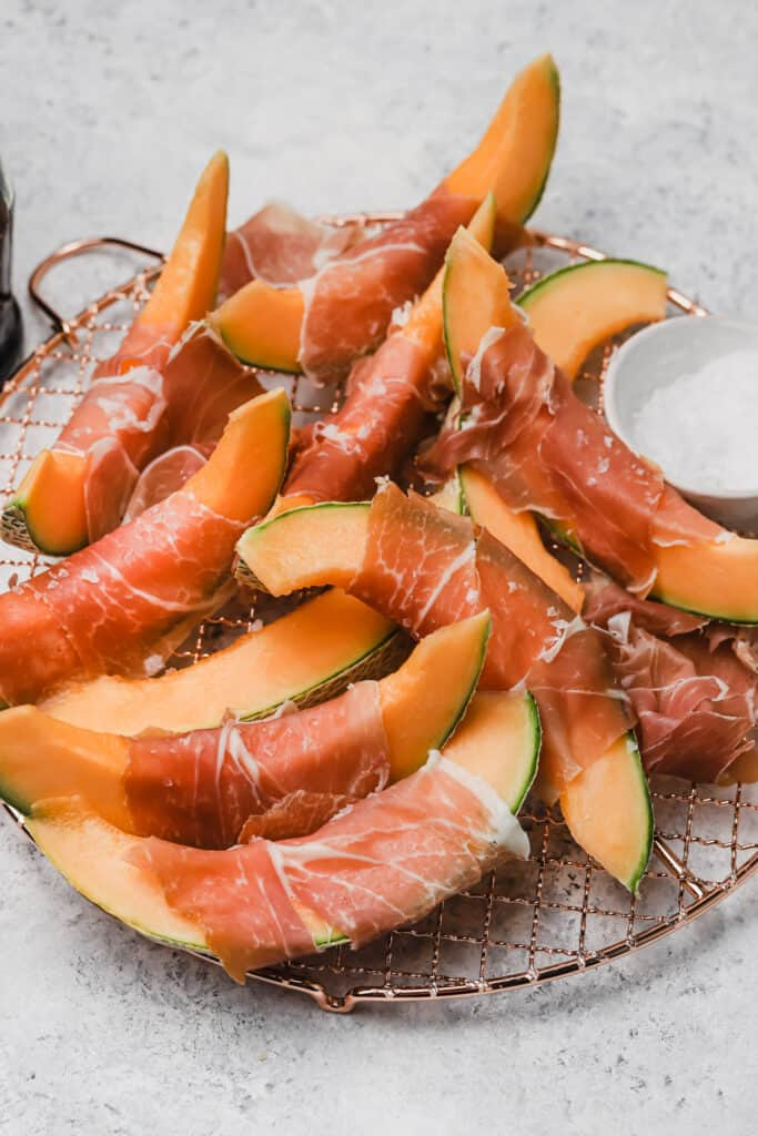 Cantaloupe with prosciutto and balsamic on a wire rack
