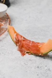 Cantaloupe wrapped in prosciutto san daniel