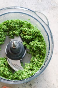 Finely chopped arugula pesto in food processor