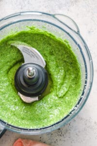 Fresh arugula pesto in a food processor