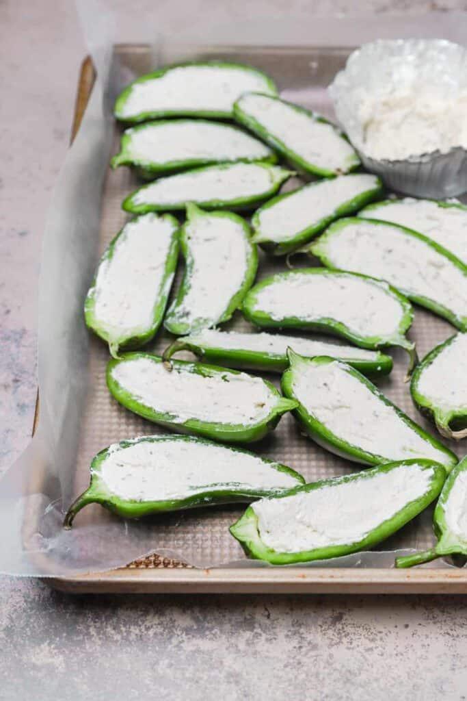 Halved jalapeños stuffed with Boursin