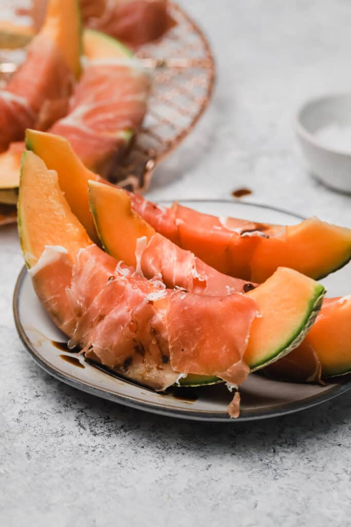 Prosciutto and melon with balsamic on a plate