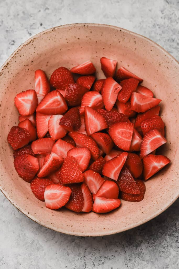hulled strawberries in a bowl