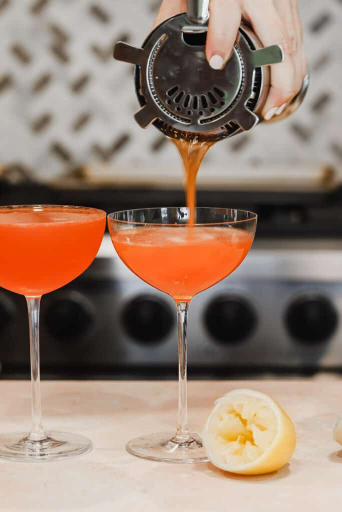 Two paper plane cocktails in coupe glasses