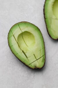 diced avocado with peel still on