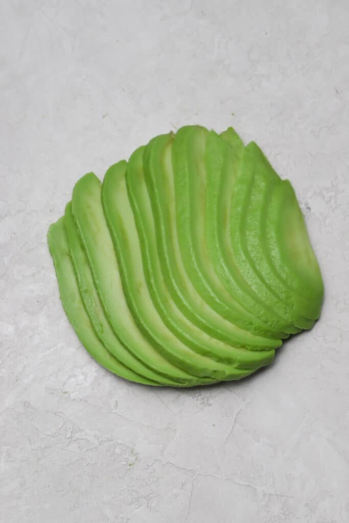 fanned out thinly sliced avocado