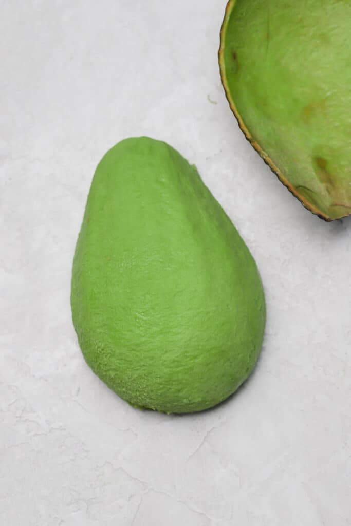 thinly sliced avocado on a gray board